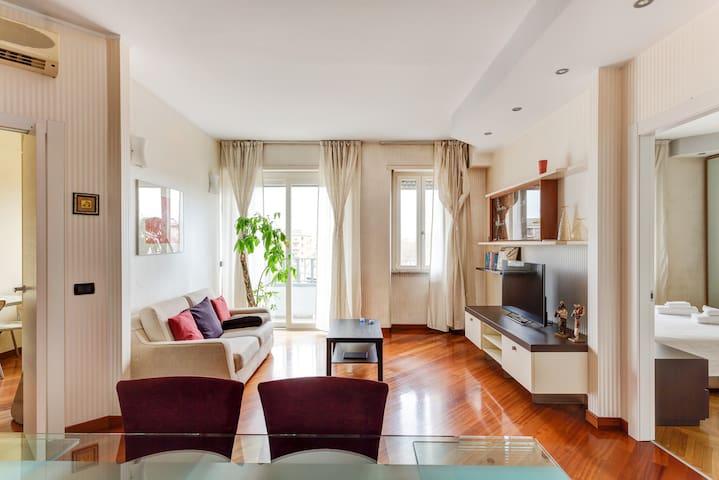 The living room - balcony, TV, AC, sofa bed x2