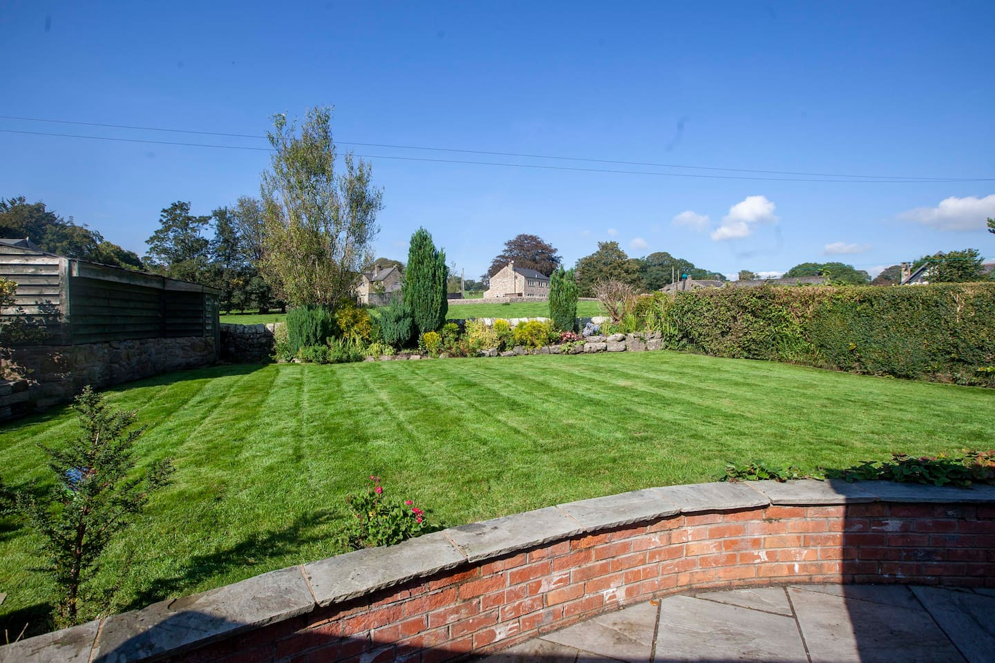 Back garden enclosed, with views of surrounding fields
