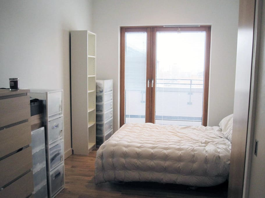 Bright clean room, comfy double bed with wardrobe and storage, ensuite shower and private balcony.