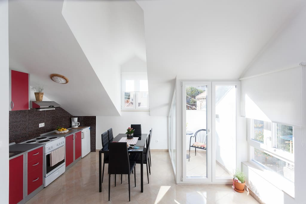 Dining area, kitchen and balcony