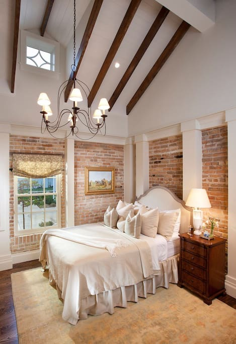 Private bedroom with vaulted ceilings and chandelier.
