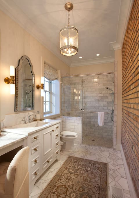 Private bathroom with large walk in marble shower.