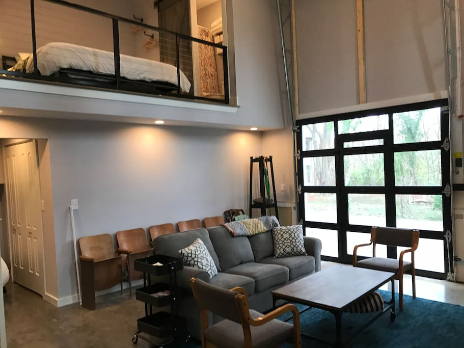 The open floor plan, lofted bedroom, and vaulted ceilings give a very spacious vibe.