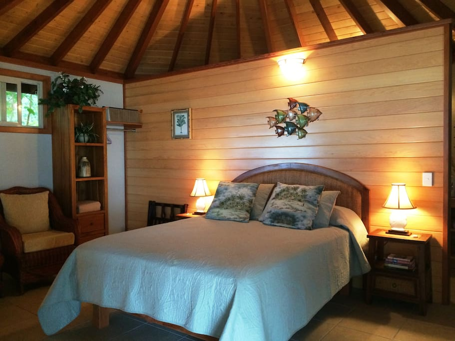 Pillow-top Queen mattress, tropical furnishings, screened windows, ceiling fan, cupola...