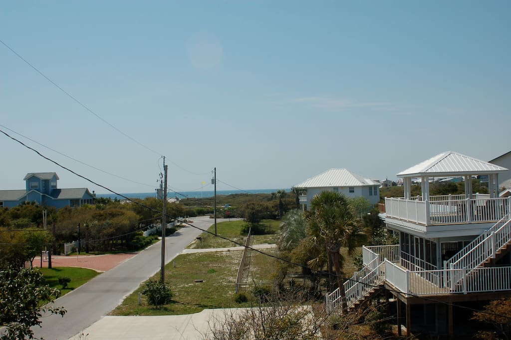 3 houses down and a boardwalk to the beach.....