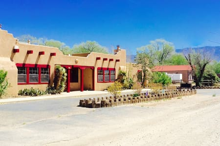 Room has queen bed, full bath, walk-in closet, and outdoor view of Sandia Mtns in the distance. TV, DVD player, wireless internet, soap,  heat/ AC in room.  Hairdryer,  iron, toothpaste, toothbrush, extra towels can be provided upon request.