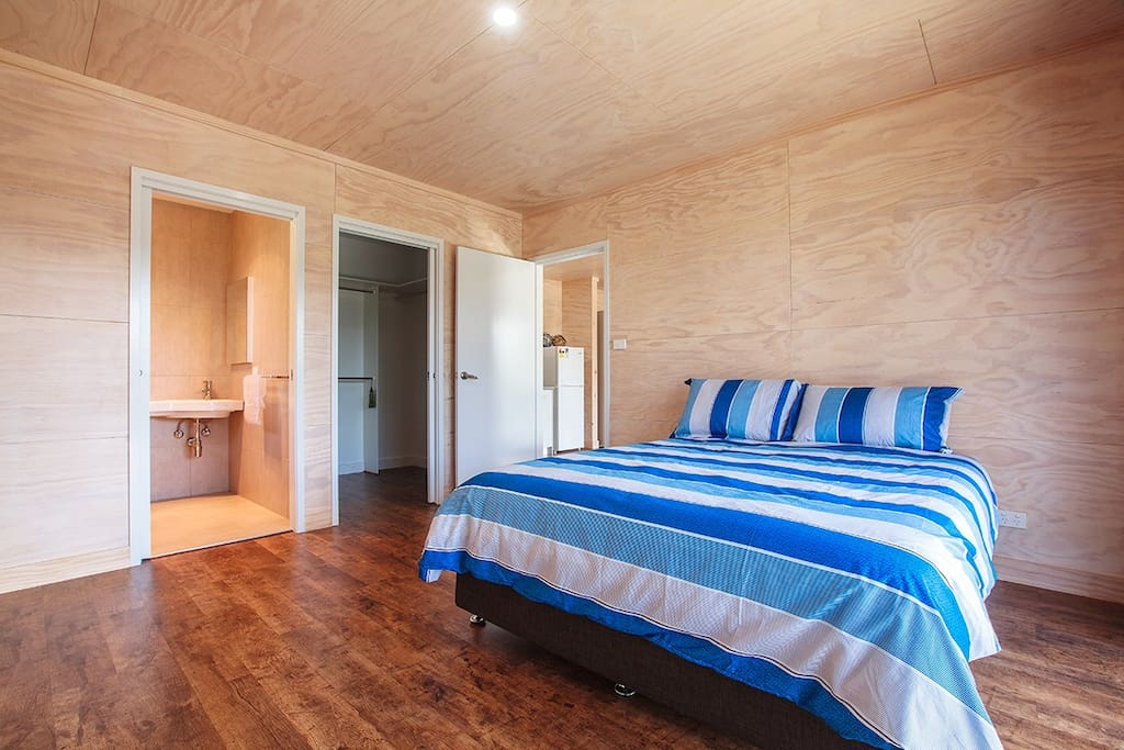 Bedroom with Queen size bed, bathroom and walk in robe.