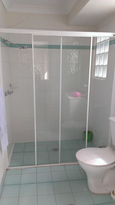 Private bathroom with double shower.