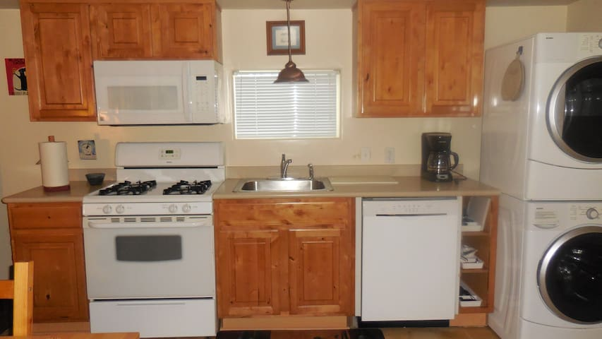 Full-size kitchen with dishwasher and W/D. The kitchen is stocked with spices, coffee and tea! All dish soap, dishwasher and laundry soap provided.