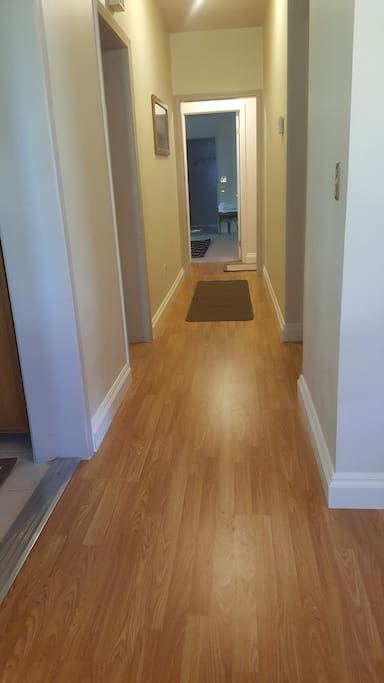 Entry hallway to 2 bedrooms with new baseboard.