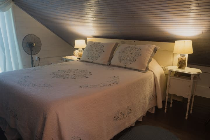 The private upstairs bedroom has a comfortable queen memory foam mattress and lots of available pillows.