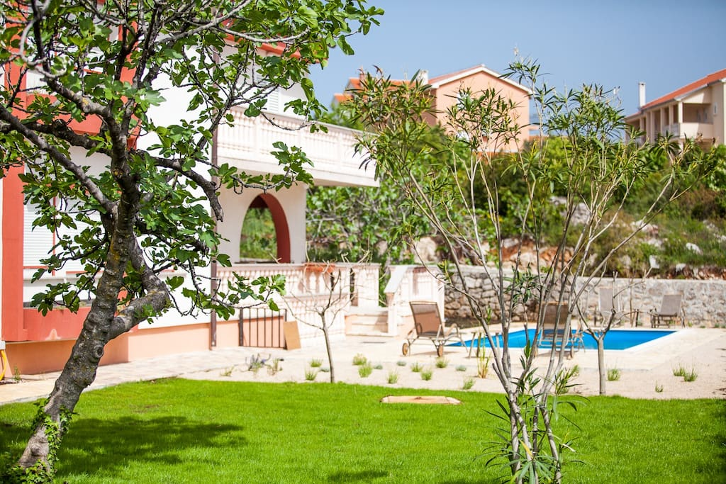 Large Mediterranean garden with pool