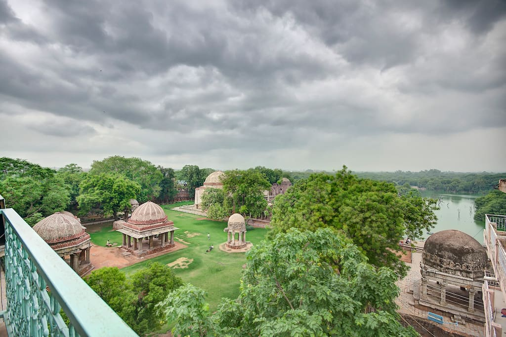 A Breathtaking view from the Terrace. One of the  best view at the heart of Delhi ! The 13th Century monuments built by Firoze Shah Tughlak and a lake - Hauz Khas.