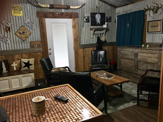 The rustic barn feel surrounds you in this entertaining space.  No couch, just chairs.  If you desire to lay around, the firm queen bed is just pulled out for you to do just that!