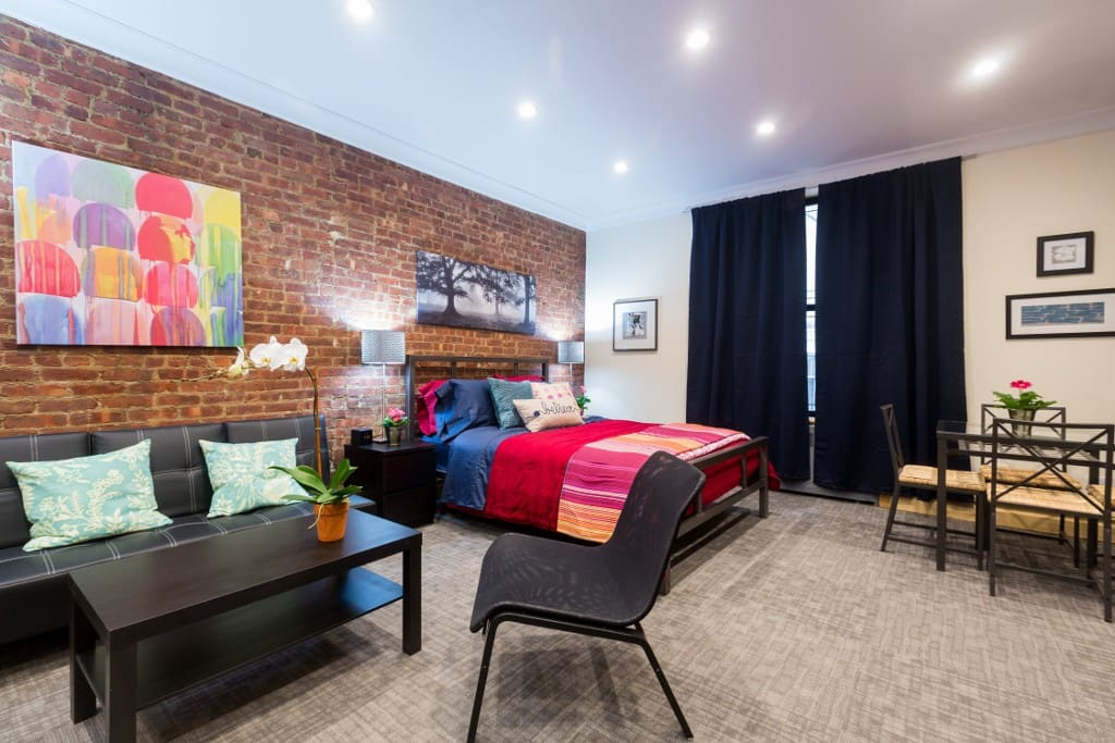Apartment features original exposed brick