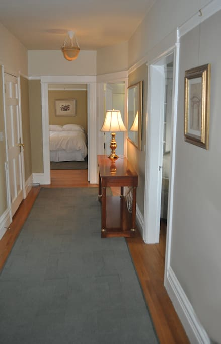 Hallway with dining room to right and bedrooms beyond