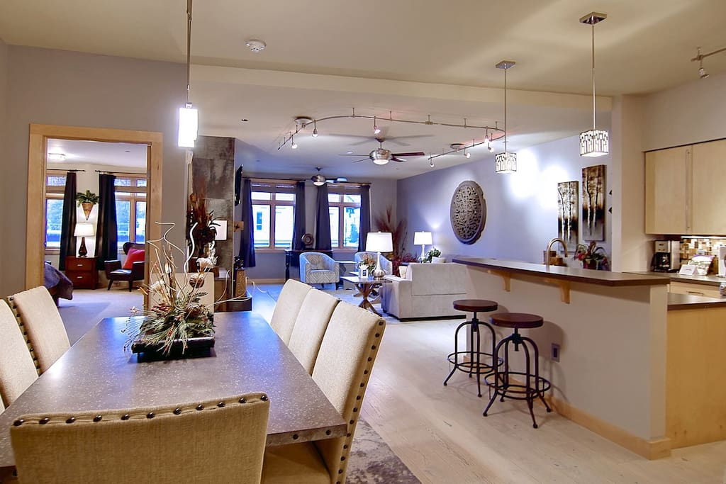Beautiful open floor-plan with modern high-end furniture and finishes like white washed hardwood floors, stainless steel, stone counter-tops and imported European maple cabinets.
