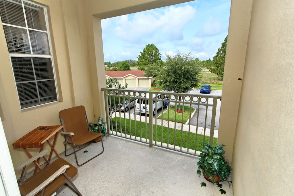 Take time out in the evenings and sit on this shaded balcony to look out to the conservation area just behind this vacation condo in the Terrace Ridge community.