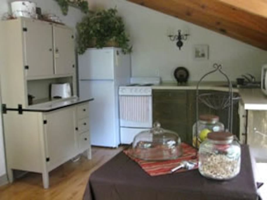 Kitchen area with refrigerator, stove/oven, dishwasher, microwave and toaster