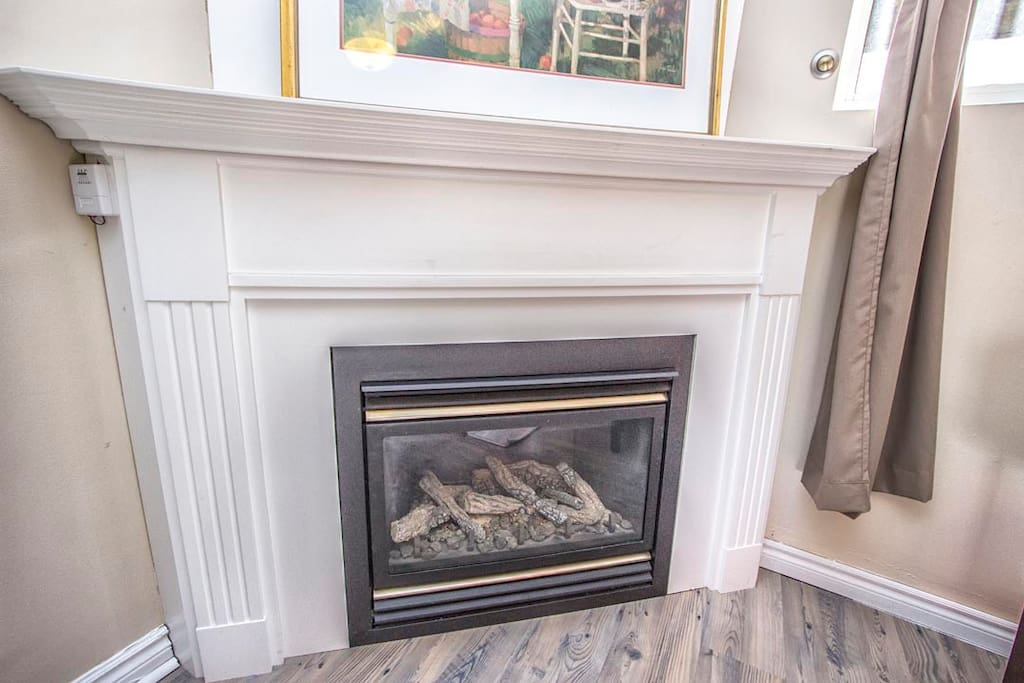 corner fireplace adds warmth ambient to the living room