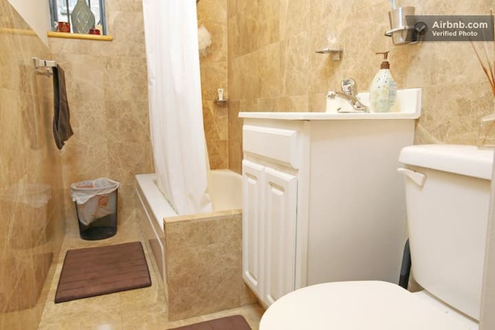 Fully Marble Bathroom that was recently renovated. The shower has strong pressure and very hot water!