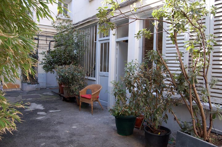 Art Studio on courtyard with trees
