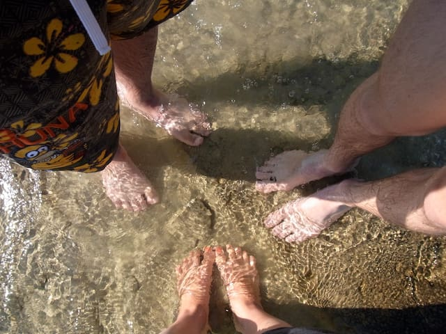 The swimming is sandy bottom, warm shallow entry and crystal clear water