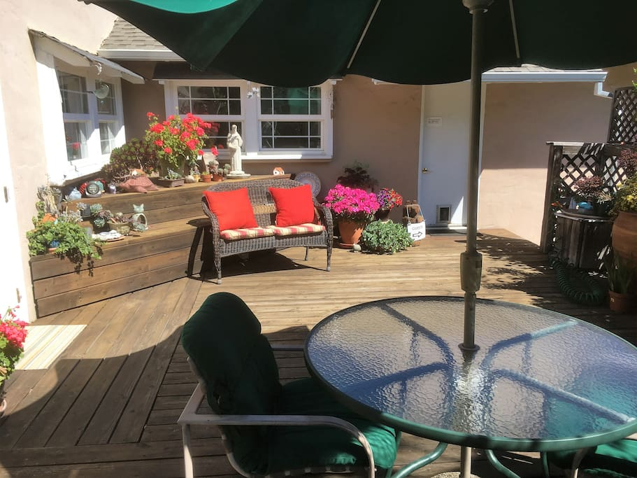Guest's deck to relax, enjoy the garden and have a glass of wine