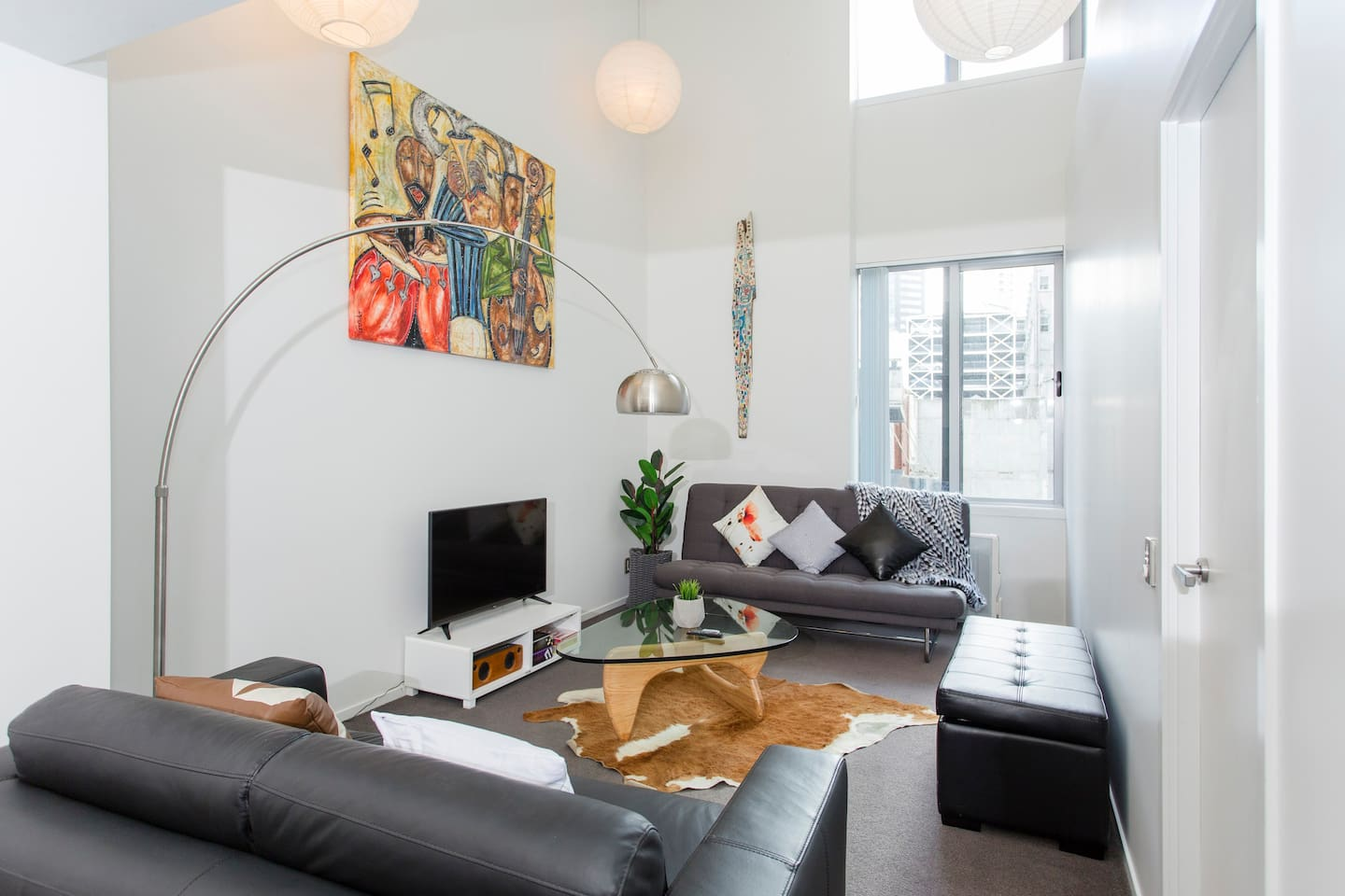 Great open plan living with high stud ceilings giving the apartment a wonderfully spacious feel