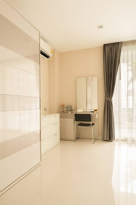 Wardrobe and table in the bedroom.