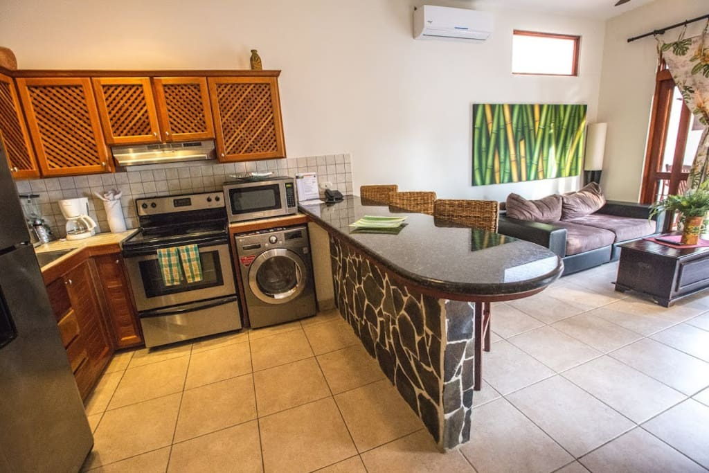 Full kitchen with breakfast bar and stainless steel appliances
