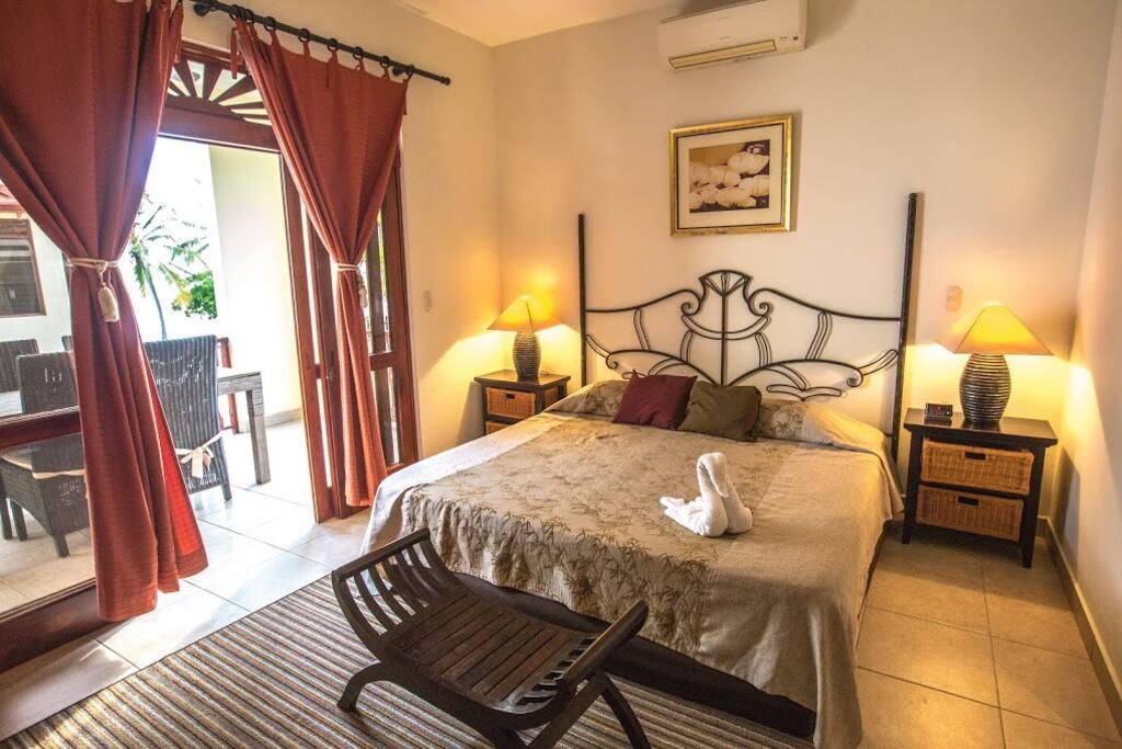 Master bedroom with en-suite bathroom and balcony access