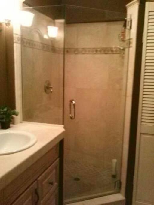 Travertine and glass shower.