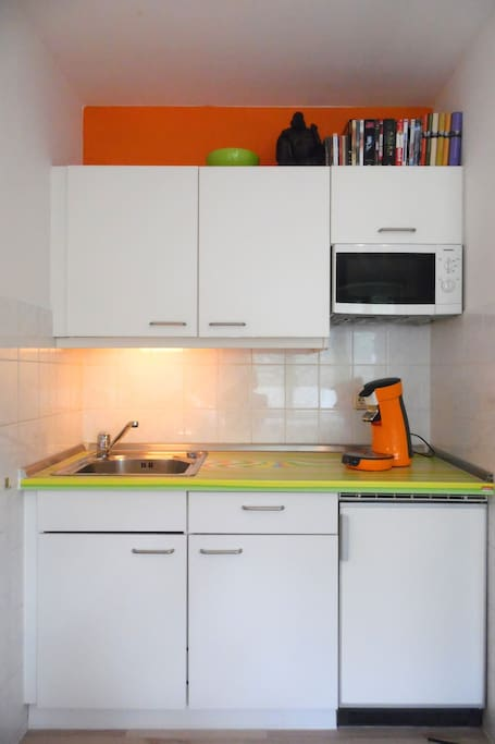 kitchen corner with mocrowafe, ceran stove, coffe maker, toaster, hot water boiler and more