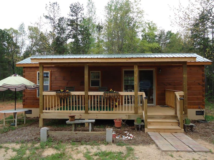 one log cabin in woods w  fishing