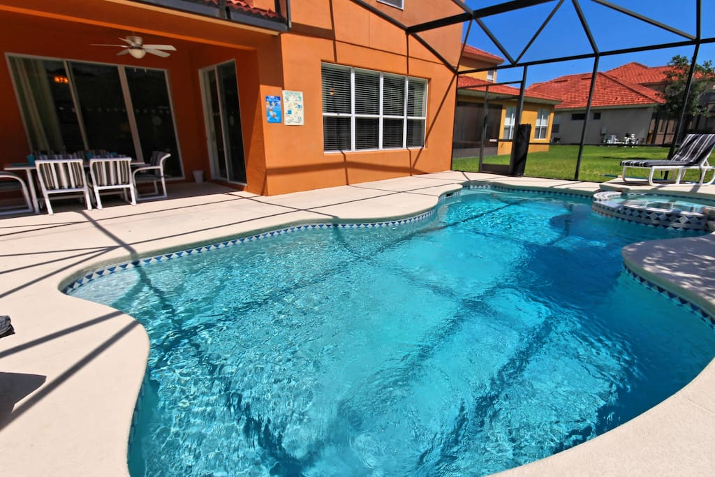 Enjoy family fun together and make hundreds of happy memories to take away and cherish forever of your days spent under the Florida sun in and beside this sparkling salt-water pool and bubbling spa.