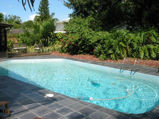 Solar heated Pool with sun deck in background