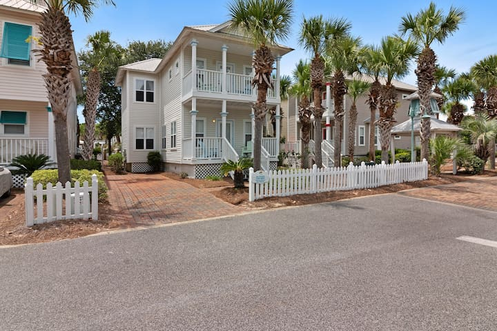 Family cottage w/ four porches & shared pool - walk to beach, dining & more!