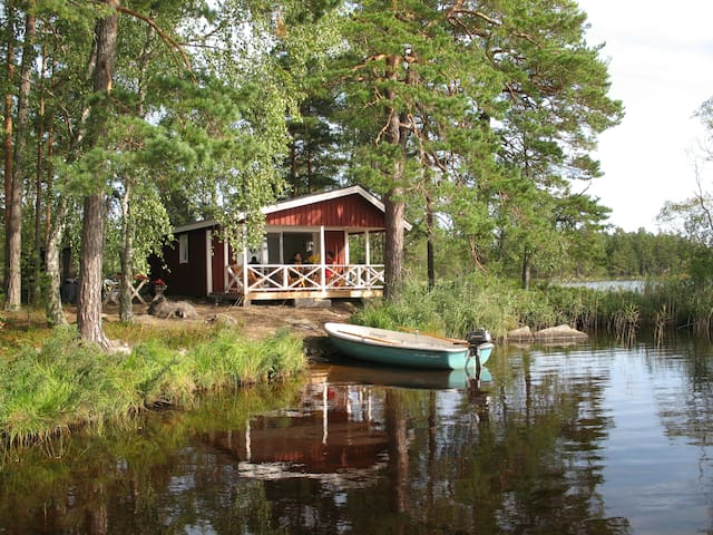 Cottage on an private island with motorboat