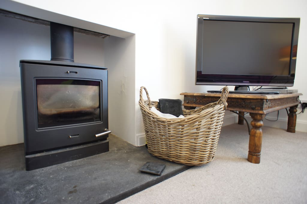 Spacious sunny lounge with Log burning stove,perfect for those winter nights