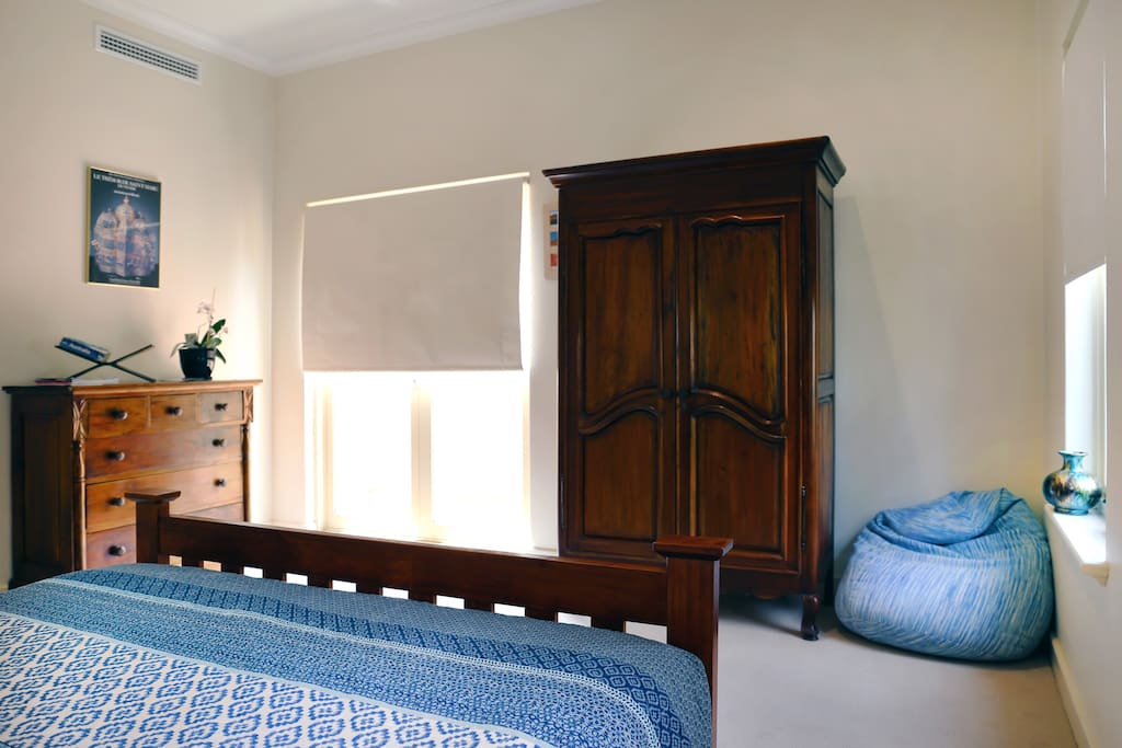 Chest of Drawers, Wardrobe, bean bag and private entry.