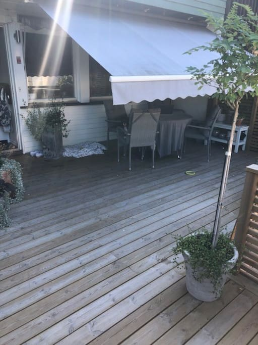 Lovely outdoor space with dining table, Weber Grill etc
