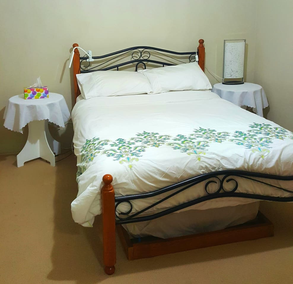 Double bed. Trundle beneath. 2 bedside tables, lamps & power supply each side of the bed.