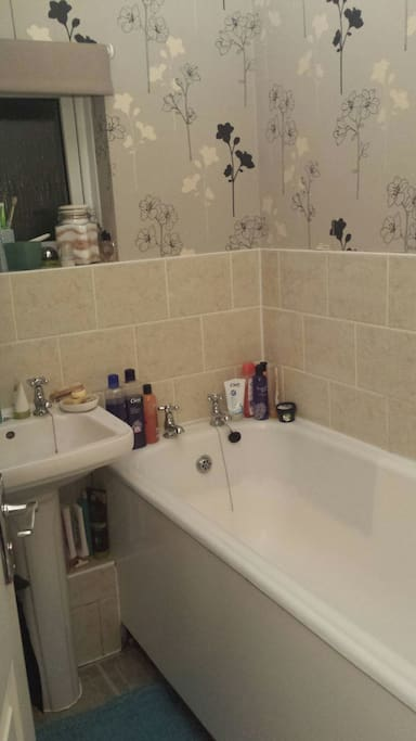 Bath with shower.