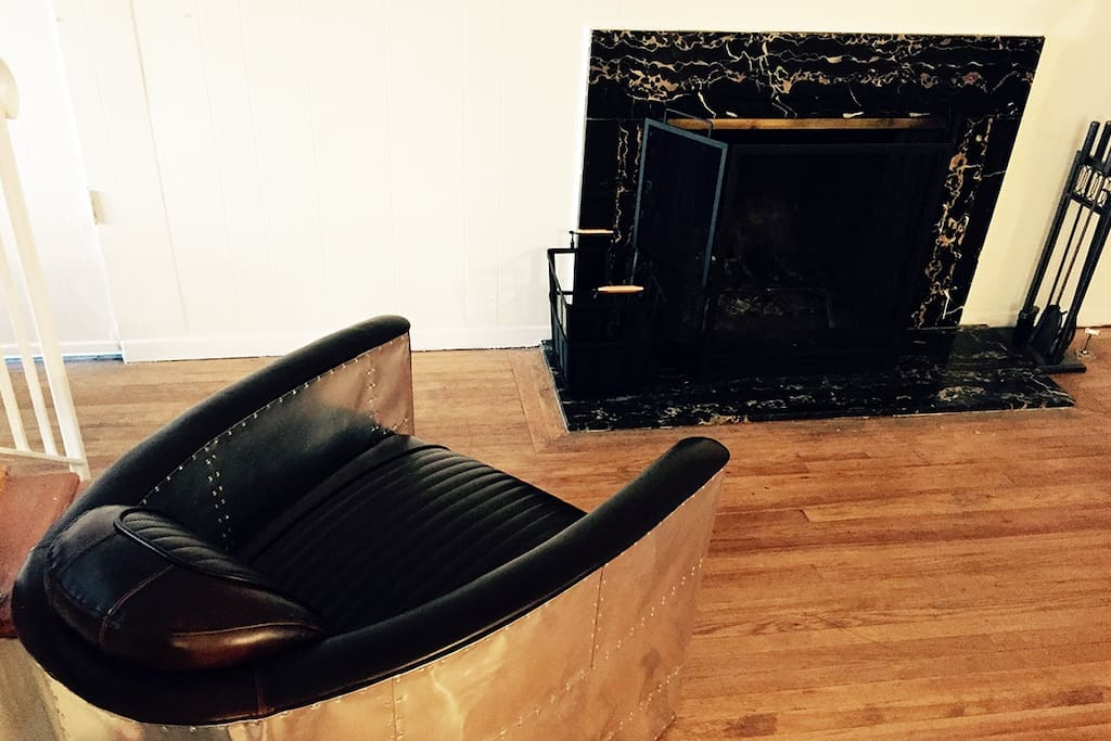 Leather Airplane Chair and Granite Fireplace to Relax!