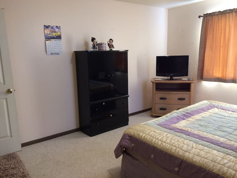 Again another view of bedroom.  Flat screen tv with cable and drawers for storage.
