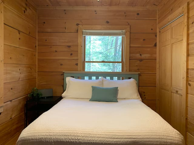 Our cozy second bedroom features a firm full-sized bed
