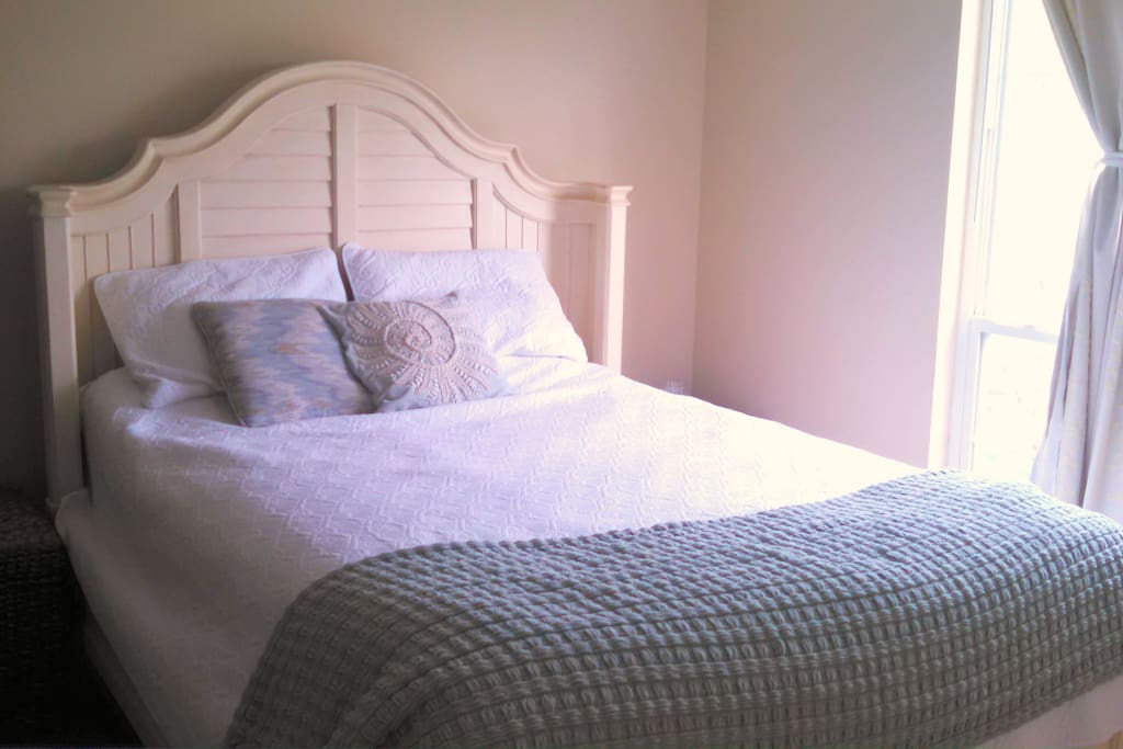 Bedroom is cozy with queen bed for sweet dreams.
