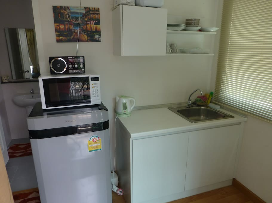 You can make Tea Coffee and Toast and heat meals. Small kitchin.