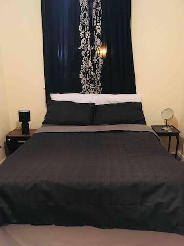 Bedroom, includes wardrobe, double bed and linen.